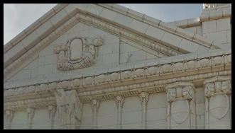 Close up of the pediment on 5400 Clark Beaux-Arts style